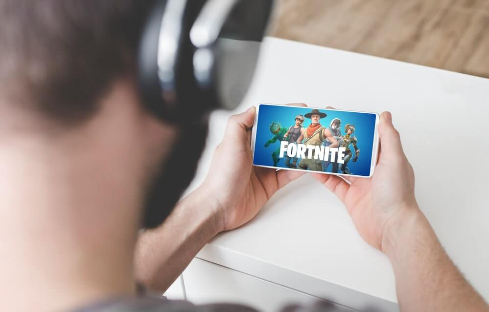 a man playing fortnitenexus
