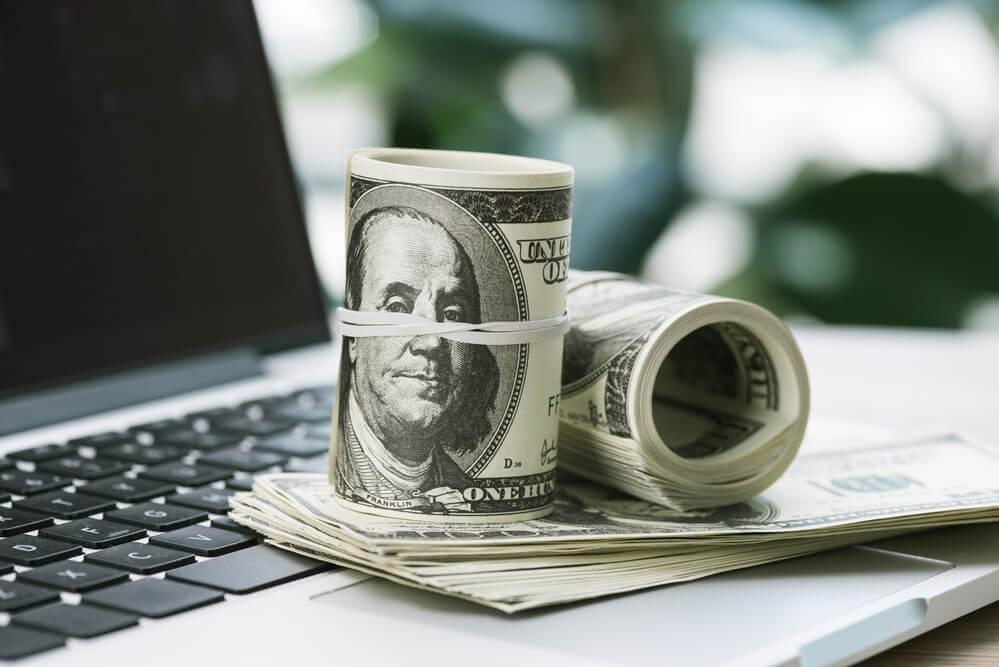 dollar cash on a laptop