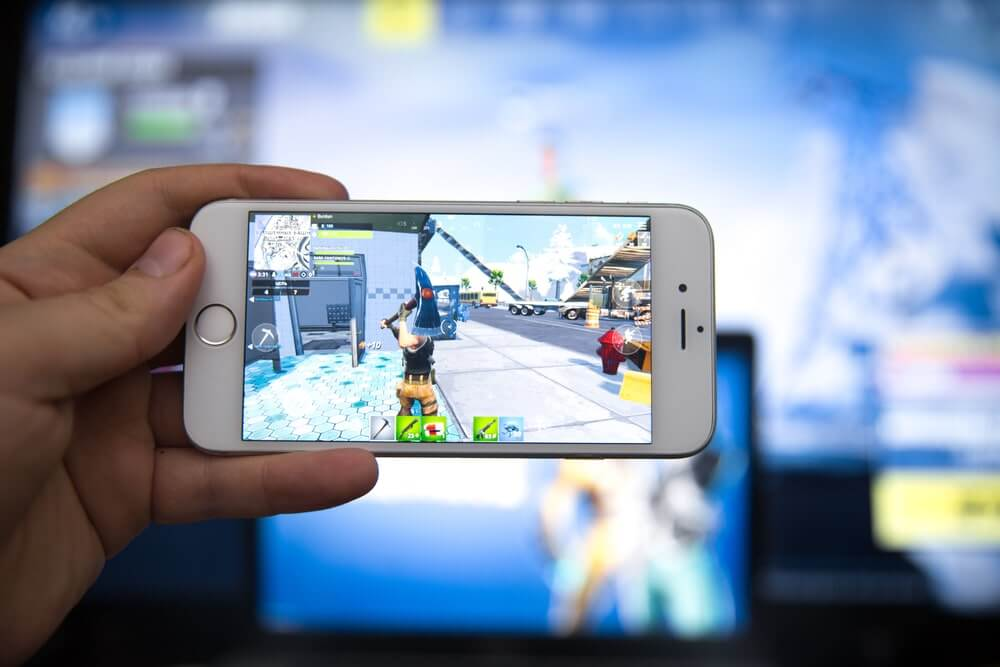 Someone playing Fortnite on Iphone
