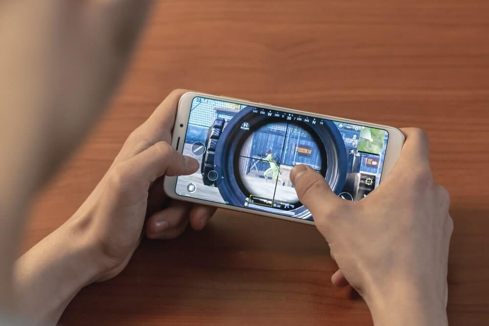 Man playing Fortnite on smartphone
